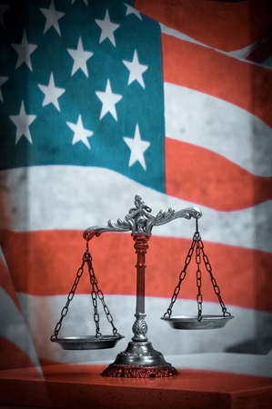 Scales of justice and united states of america flag 版權商用圖片