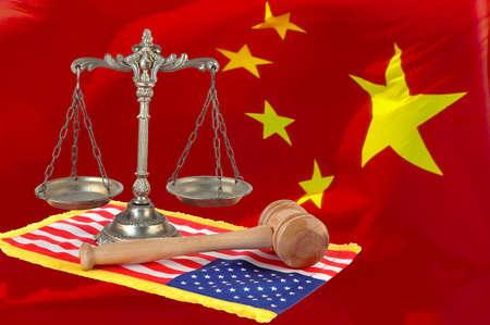 scales of justice and wooden gavel on the united states flag, chinese flag background Stock Photo