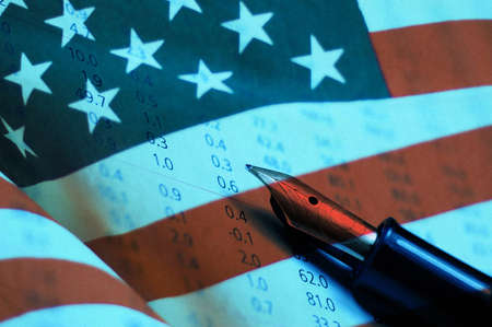 Fountain pen on stock chart and united states of america flag