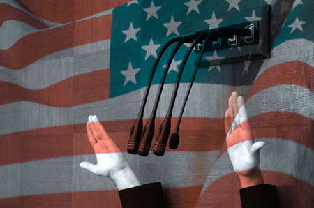 Hand of american politician in parliamentary debate, United states flag background