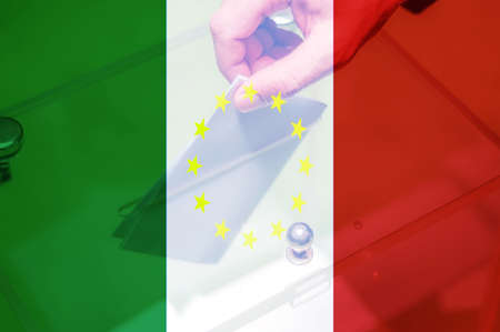 Hand putting ballot in the box with Italy flag and yellow stars. Italian referendum on leaving the European Union