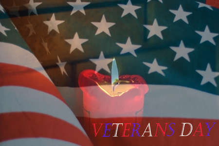 Candle on the United States flag with text Veterans day