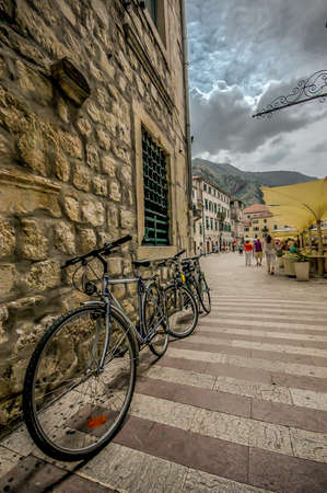 KOTOR, MONTENEGRO – JUNE 14, 2011: Bicycle in old town Kotor on the wall