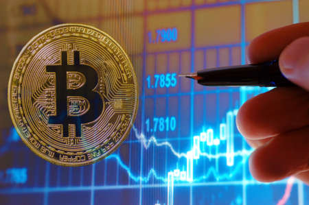 Bitcoin currency and stock chart Stock Photo