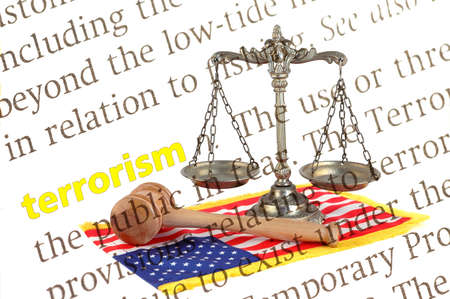 dictionary definition of terrorism with Scales of justice, gavel and American flag