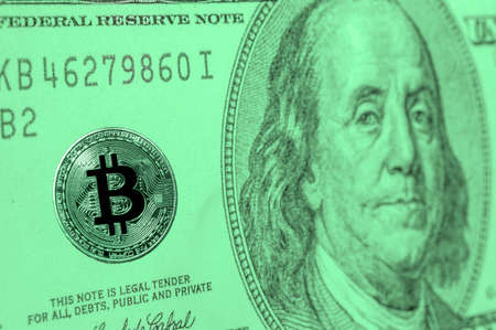 bitcoin currency on the one hudred United States Dollar