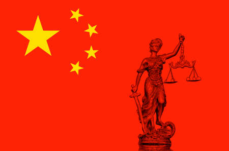Statue of lady Justice on the Chinese flag Stock Photo