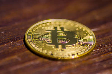 Bitcoin crypto currency on the wooden background, selective focus Stock Photo