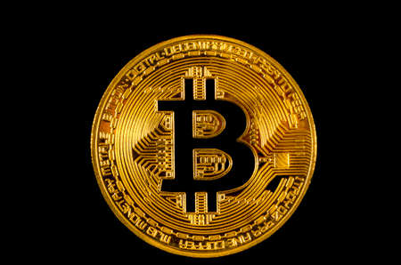 Bitcoin crypto currency on the black background