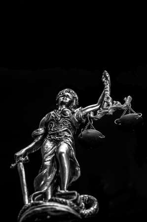Statue of Justice on the black background, view from below Stock Photo