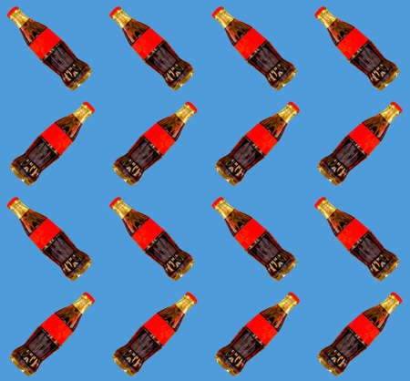 Seamless pattern red bottle of  on the blue background
