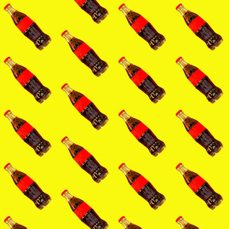 Seamless pattern red bottle of  on the yellow background