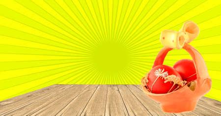 Easter eggs in a porcelain bowl on the wooden floor and yellow sunburst background