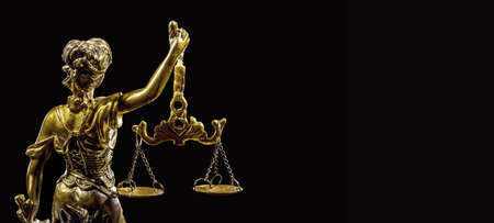 Statue of Justice on the black background, back view Stock Photo