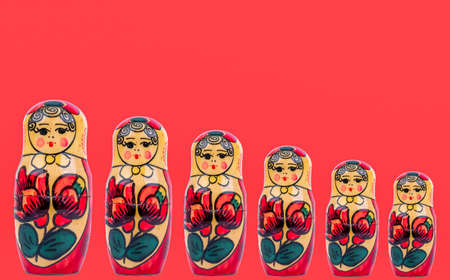 wooden figures of Russian babushka on a red background