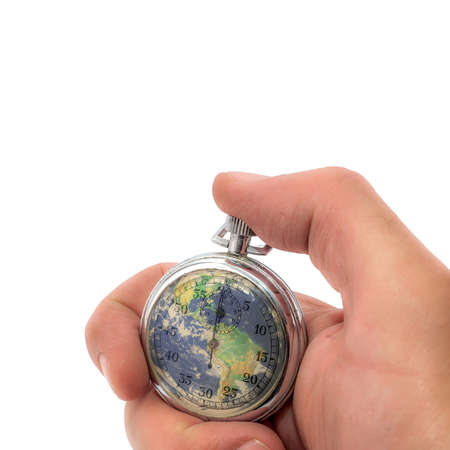 Hand holding a stopwatch with the planet earth on a white background. Save the planet Stock Photo