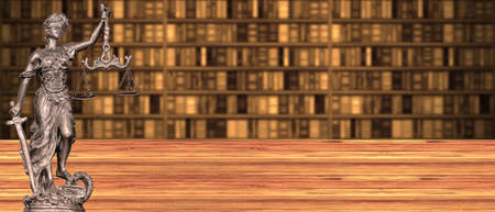 Statue of Justice on a red wooden floor with blurred book background