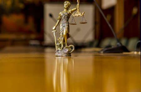 Statue of Lady Justice on the table with  microphones in the conference room Stock Photo