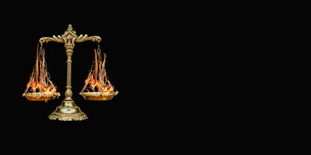 scales with burning tasses on a black background