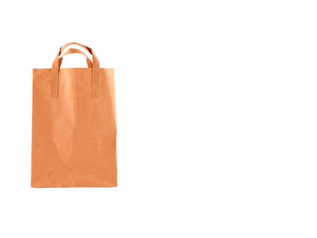 Blank brown paper shopping bag on white background