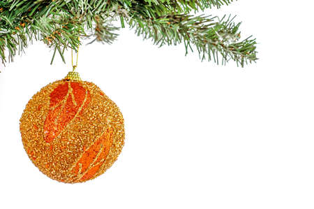 Golden Christmas ball on tree branch on the white background. New Year and Christmas decotarion