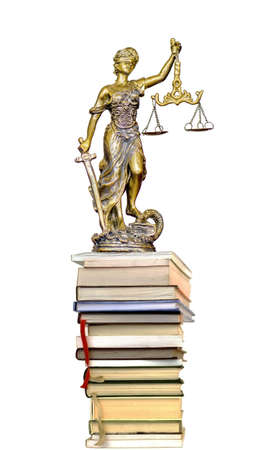 Statue of Justice on the pile of book on a white background Stock Photo
