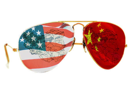 BELGRADE, SERBIA  December 17, 2017:Sunglasses with an American and Chinese flag and a map of Iran on white background Editorial