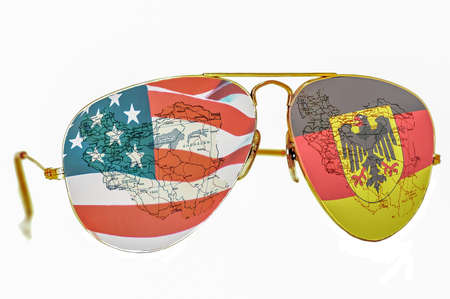 BELGRADE, SERBIA  December 17, 2017: Sunglasses with an American and Germany flag and a map of Iran on white background