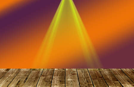 a beam of reflector on a wooden stage an orange red background Stock Photo
