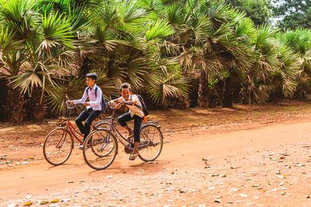 Siem Reap, Cambodia - December 6, 2016: Children returning from school.