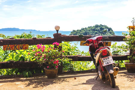 motobike: Koh Lanta Island, Krabi Province, Thailand - December 10, 2016: Honda motobike on the observation point near exotic beach