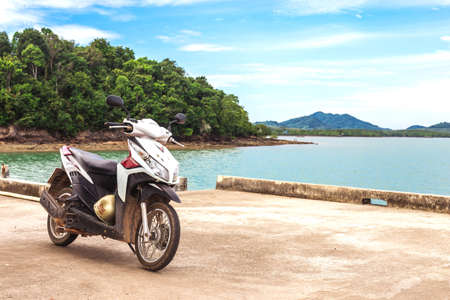 motobike: Koh Lanta Island, Krabi Province, Thailand - December 11, 2016: Honda motobike on the observation point near exotic beach