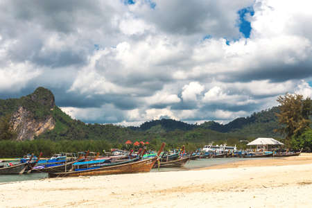 Ao Nang, Krabi Province, Thailand - December 16, 2016: Exotic beach. Sea, long tail boats, yachts and tropical forest.
