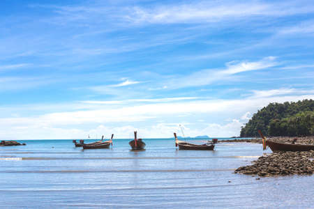 Fishing village at low tide - ethnic buildings and long tail boats. Koh Lanta Island, Krabi Province, Thailand. Stock Photo