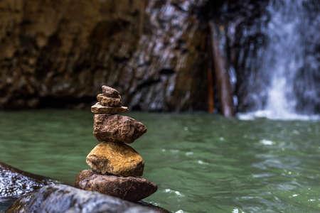 steadfast: Stones balance near waterfall. Concept of harmony. Rock zen tower