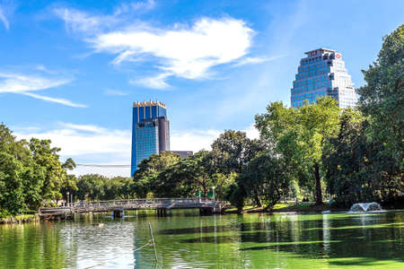 lumpini: Bangkok, Thailand - November 27, 2016 : Lumpini Park - picturesque city view, lake and skyscrapers Editorial