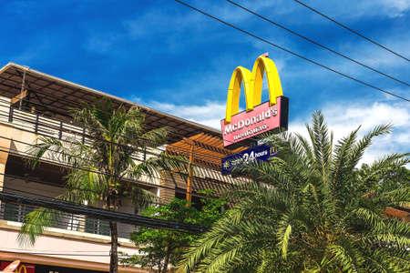 macdonald: Krabi Town, Thailand - December 15, 2016: McDonalds logo and palms.