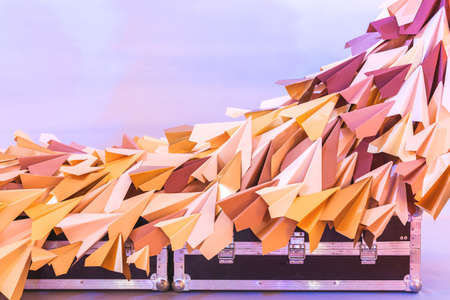 Vintage Suitcases and Paper planes. Design and travel concept. Model of runway strip. Origami.