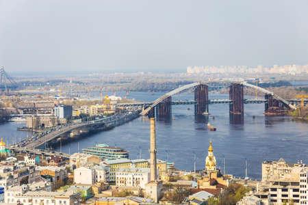 Aerial view of the Kiev city, Kyiv, Ukraine. Dnieper river and bridges. Podil.
