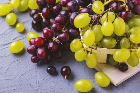 Fresh grapes on gray stone background. Copyspace. Horizontal View