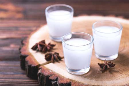 Arabic alcohol drink Raki with anis on wooden background.Turkish and Greek Traditional aperitif arak, Ouzo
