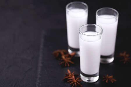 Arabic alcohol drink Raki with anis on slate black background.Turkish and Greek Traditional aperitif arak, Ouzo Stock Photo