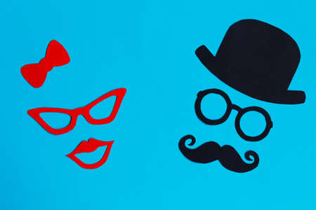 Male and female silhouette paterns on the blue background. November concept. Prostate Cancer and mens health awareness. Funny party faces. Copy space