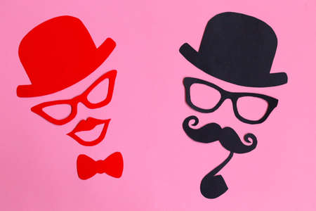 Male and female silhouette paterns on the pink background. November concept. Prostate Cancer and men's health awareness. Funny party faces. Copy space