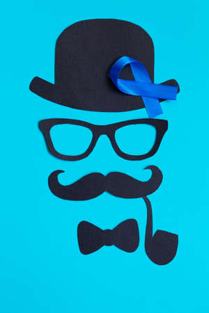 Blue ribbon symbol on blue background. Movember concept. Prostate Cancer and mens health awareness.