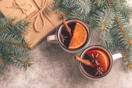 Hot mulled wine in a small vintage cups with christmas tree and present. Christmas or winter warming drink. Top view. Copy space