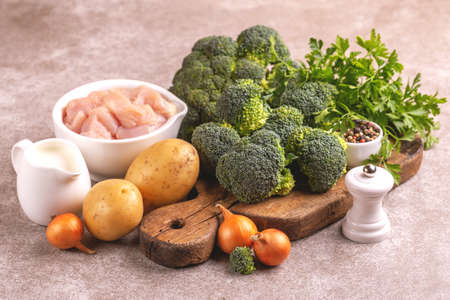 Fresh ingredients for tasty pureed broccoli soup. Healthy food concept. Horizontal view. Copy space