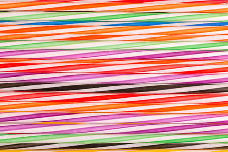 Colorful plastic straws background. Event and party supplies. Earth pollution concept