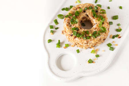 Cream cheese with green onions and herbs, dip sauce. Breakfast concept Standard-Bild - 126865601
