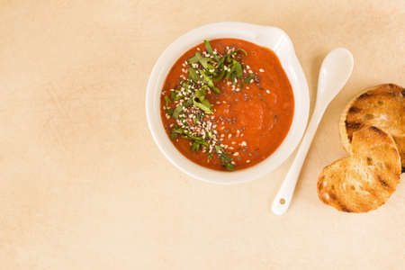 Italian pureed tomato soup gazpacho with croutons and fresh basil. Healthy food concept.